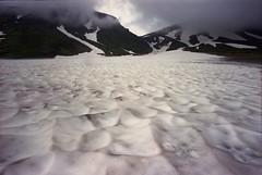Snow filled valley (threepinner) Tags: summer cloud snow mamiya 50mm negative press f63 selfdeveloped iso160 sekor 大雪山国立公園 super23 mountainsnaps 裾合平 taisetsunationalpark mtkumagatake 熊ヶ岳