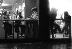 Coupling (phillytrax) Tags: new york city nyc newyorkcity urban blackandwhite bw usa ny window monochrome america couple eyecontact unitedstates manhattan streetphotography midtown grayscale chipotle diners 42ndstreet candidphotography restaurantwindow