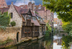 Bruges, Belgium (Cat Girl 007) Tags: city panorama house home architecture river outdoors photography canal europe downtown belgium medieval historic bruges residence quaint picturesque idyllic brugges waterway oldfashioned flanders benelux colorimage famousplace traveldestination horizontalcomposition magicunicornverybest