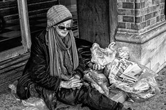 Bag Lady has a name. Her name is Ingrid. (sophie_merlo) Tags: poverty street blackandwhite bw bristol noir candid strasse political politics homeless poor streetphotography rue 1000 mentalhealth streetperson baglady 300faves
