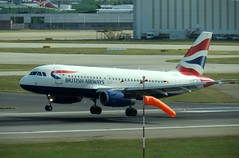 British Airways Airbus A319-131 G-EUOI landing on at London Heathrow Airport (WlNGS) Tags: london plane airport heathrow jet aeroporto terminal aeroplane apron landing flughafen flugzeug britishairways aeroport aeropuerto runway airliner avion lhr windsock egll londonheathrowairport geuoi airbusa319131 runway27l