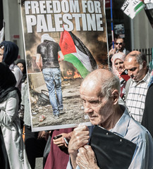 Clinging On (MoAzar) Tags: old man berlin london sign march israel al war peace iran palestine jerusalem protest grandpa demonstration solidarity tired worn gathering conflict aged wrinkles injustice exhausted gaza alquds 2015 quds khomeini netenyahu