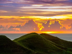 It ends over the hills (Pipo De Jesus) Tags: 500px sunset sunsets orange skies sky solitude serenity peace peaceful mountain mountains hill hills vayang rolling batanes philippines grass grassland green nature