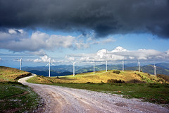 windmill farm in mountain (Mikel Martnez de Osaba) Tags: road park blue light sky cloud white mountain green mill industry nature ecology windmill beautiful field electric clouds landscape wings energy technology power wind path farm environmental generator electricity environment rotation watts generation turbine alternative sustainable global sustainability renewable rotate generate