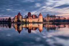 Trakai Island Castle (TheFella) Tags: morning travel blue trees sky lake reflection slr tower castle water fairytale clouds digital photoshop sunrise landscape island photography dawn photo nikon europe european cloudy fineart towers smooth landmark baltic resort photograph processing mystical bluehour dslr cloudscape lithuania vilnius lithuanian trakai d800 lietuva postprocessing northerneurope travelphotography karaim troki karaites trakaiislandcastle islandcastle galv thefella traksalospilis lakegalv lietuvosrespublika conormacneill thefellaphotography