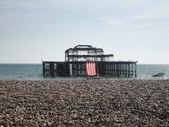 Brighton Beach Cliches : Two for the price of one (brightondj - getting the most from a cheap compact) Tags: uk red sea colour beach pier brighton deckchair britain pebbles westpier engand cliche