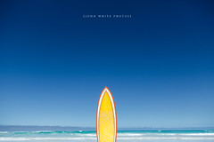 Surf (john white photos) Tags: ocean sea orange abstract yellow coast surf board culture australia bluesky retro coastal surfboard 1970 1980 southaustralia eyrepeninsula