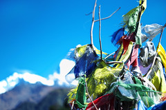 Mountain-top Prayer Flags - Nepal (gearidhayes) Tags: nepal mountains green trekking intense buddhist markets culture bridges vivid friendly tuktuk kathmandu nepalese colourful porter sari forests annapurna himalayas hindi sadhu jungles respectful teahouses ropebridges