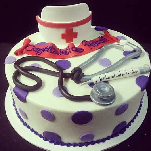Nursing Cake With Nurse S Hat Stethoscope And Syringe A Photo On