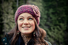 Portrait of a young woman wearing a cute headband in the forest. (Every Day Adventures) Tags: park travel trees people woman canada nature beautiful smiling fashion horizontal youth forest hair walking fun outdoors nose photography freedom healthy model eyes adult natural britishcolumbia buttons gorgeous teeth joy longhair style peaceful happiness lookingup adventure foliage trail curly environment eyelash organic joyful beanie excitement gems enjoyment leatherjacket adultsonly headband stylish caucasian darkforest prettywoman offcenter greenbackground 2530years colorimage caucasion youngatheart lookingforward onewomanonly leisureactivity coldtemperature knittedheadband eflower facingahead cblackjacket leisureactivityportrait