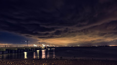 Storm clouds over Woody Point Jetty (www.jamespartridge.photo) Tags: ocean sunset night clouds lights evening lowlight rocks jetty australia brisbane calm qld redcliffe moretonbay woodypoint