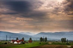 Rain is coming in (cristiansamoilescu) Tags: sunset sky house color green colors landscape colorful cloudy farm hill dramatic land