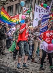 Pride Scotia Parade 2012 (FotoFling Scotland) Tags: gay poster march rainbow edinburgh flag crowd banner balloon jeans royalmile denim gaypride cobbles highstreet hairylegs equality pridescotia