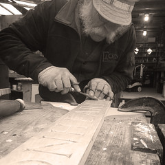 Carving the Quarterboard (Lostboy Photography) Tags: quarterboard carving carver wood shipsname chisels dragonheart