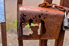 Long-gone Lock (HTT!) (violetchicken977) Tags: texturaltuesday htt lock irongate rust chain padlock decay