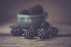 Blackberries Dark & Moody (jm atkinson) Tags: desserts macro purple blackberries tabletop 105mm d700 wooden table bokeh hbw