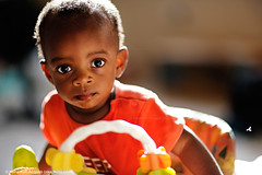 Daddy, come let's play (Nana Kofi Acquah) Tags: boy portrait baby black canon toddler bokeh ghana accra nanakofiacquah ef85mmf12lii 5dmarkiii