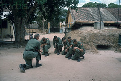 ca. March 1966, Near Saigon, Vietnam (tommy japan) Tags: trees people men soldier outfit clothing war uniform asia southeastasia vietnamese asians many military religion praying group battle vietnam hut males leader christianity posture caring kneeling adults saigon hochiminhcity comforting clergy religiousleader southeastasians militarypersonnel historicevent asianhistoricalevent northamericanhistoricalevent unitedstateshistoricalevent vietnamwar19591975 vietnamesehistoricalevent militaryuniform southeastregion