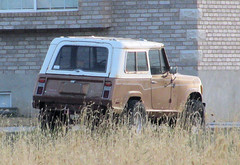 Jeep Commando (Eyellgeteven) Tags: brown white classic vintage rust jeep 4x4 rusty dent rusted vehicle kaiser amc 1970s suv dents commando beatup jeepster beater madeinusa americanmade fourwheeldrive dented convertable twotone jeepcommando bigtires jeepstercommando eyellgeteven