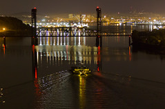 IMG_14850_Breaking Wake (Terry Frederic) Tags: lighting usa night oregon docks buildings portland marine cityscape bridges rivers willametteriver fremontbridge tugboats railroads universitypark barges swanisland universityofportland riverscape portlandoregonuniversityofportland canoneos550d canont2i terryfrederic lightroom36processed