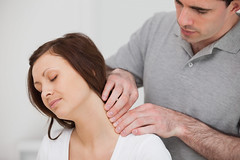 Man massaging the neck of his patient (Atlanta Chiropractic Group) Tags: woman man male closeup female office sitting hand room longhair patient medical indoors health doctor medicine brunette pressure youngadult suffering stressed painful recovery 30s touching chiropractor illness 20s treatment caucasian physiotherapy nape brownhair displacement medicalroom therapist midadult osteopath massaging cervical physiotherapist herniation herniateddisc focusshot uppercervical
