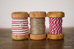 Christmas spools (life stories photography) Tags: christmas wood red stilllife white spools holidays december natural packaging ribbon twine crafting 2013 beverlylefevre