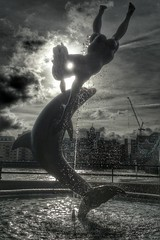"""Girl with Dolphin"" (35mmMan) Tags: flickrandroidapp:filter=none girl dolphin statue girlwithdolphin davidwynne london towerbridge river thames tourist sony xperia snapseed stkatharinedocks android cameraphone uk england sculpture art"