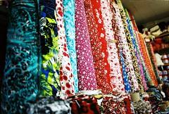 Bolts 2 (aaronvandorn) Tags: 50mm jerseycity buttons sewing fabric minoltasrt201 crowded vividcolors fabricstore notions rokkor smallstore bergenavenue newkirkstreet
