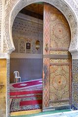 White plastic chair (halifaxlight) Tags: door light clock chair decoration morocco medina carpets fes greatphotographers archeddoor feselbalimedina