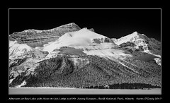 Afternoon at Bow Lake with Num-te-Jah Lodge and Mt. Jimmy Simpson, Banff National Park, Alberta (kgogrady) Tags: afternoon banffnationalpark bowlake icefieldsparkway landscape mtjimmysimpson numtejahlodge winter alberta canada building acros 2017 blackandwhite canadianlandscapes blackwhite canadianrockies fujifilmxt2 albertalakes cans2s canadianrockieslanscape albertalandscapes bw canadianmountains canadiannationalparks ab canadianlakes frozen fujinon fujifilm westerncanada xf18135mmf3556oiswr trees snow sunny xt2 parkscanada rockymountains rockies mountains moutainlake