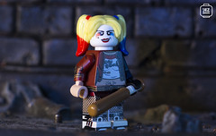 Harley Quinn (Jezbags) Tags: canon60d canon 60d 100mm harleyquinn harley quinn batman batmanthemovie batmanlegomovie macro macrophotography macrodreams macrolego upclose closeup baseballbat bat yellow red blue wall gritty lighting tattoos grafitti minifigure minifigures