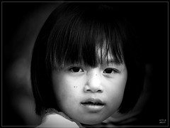 Little Girl Portrait (ulli_p) Tags: light people blackandwhite bw art girl beautiful blackbackground portraits children asia best isan artisticexpression aworkofart blackwhitephotos anotherblackpearl flickraward ruralthailand unseenasia earthasia thebestshot awardtree totallythailand artofimages bestportraitsaoi artwithinportraits canoneoskissx5