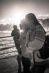 Through the Sun - Bondi 2013 (Paul Amestoy) Tags: ocean street girls sunset sea sky blackandwhite woman cloud sun white seascape black beach water girl bondi skyline clouds canon buildings walking photo blackwhite sand surf day waves pacific noiretblanc oz sydney australian wave sunny australia photograph jumper coffe bondibeach wollen 2013 blackwhitephotos canon5dmarklll