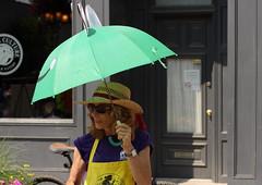 Colorful Staffer (Bert CR) Tags: street color green umbrella streetphotography vendor sales