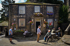 Haworth (Sven Loach) Tags: uk flowers summer england beautiful sunshine stone sisters anne emily pub warm afternoon shadows village charlotte britain candid yorkshire elderly benches bront gentleman westyorkshire customers haworth publichouse punters blackbull hangingbaskets checkedshirt