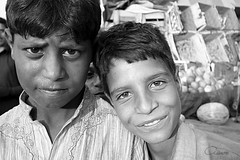 Friends Indeed (aimon's_world) Tags: poverty life pakistan boy streets girl smile face childhood kids children eyes child poor human rights innocence laughter bazaar islamabad
