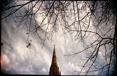 the creeping sickness #5 (mugley) Tags: city trees winter sky urban colour building film church architecture clouds 35mm catholic cross cathedral bare branches religion gothic grain perspective stpatrickscathedral australia melbourne wideangle victoria scan christian spire lightleak crappycam negative epson 135 vignetting twigs urbanlandscape gothicrevival eastmelbourne 22mm albertst v700 cloudage minorbasilica keystoning vivitarultrawideandslim wideslim supermarketfilm eximus lomophobia eximuswideandslim maybelucky shooterfun maybeferrania shooterfun400