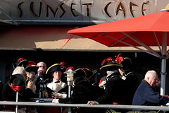 time out at the Sunset Caf (overthemoon) Tags: red men caf glasses schweiz switzerland costume suisse wine market terrace traditional feathers drinking hats sunny soldiers tradition svizzera troops plumes vevey vaud romandie stmartinsfair sunsetcaf ftedelastmartin