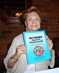 Geri and one of her many publications, Actions Against Distractions (Tatiana12) Tags: coach women michigan annarbor professional writers writer network coaching author happyhour coaches 2012 authors businesswomen stirrednotshaken womeninbusiness coachcaf coachcafannarbor