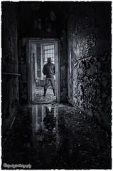 Dont look back ... (sparkeyb) Tags: light blackandwhite bw abandoned broken window wet glass hospital mono blackwhite nikon closed decay apocalypse sigma monotone creepy textures urbanexploration nhs gasmask smashed rotten mould peelingpaint 1020mm asylum derelict essex shards colchester decaying damp textured apocalyptic crumbling mental mentalhospital urbex mouldy severalls monotonal d7000 silverefex sparkeyb