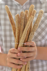 Bread Sticks in Child Hands (***VR) Tags: party food brown holiday vertical bread grey healthy hand handmade wheat bio rye bakery pastry organic breadstick healthyfood childhands wholegrain greybackground