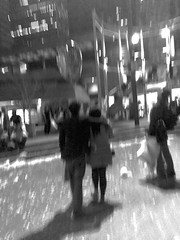 Pillow Fight: San Francisco Valentine's Day Tradition - B&W Blurry Couple with Heart Balloon (Lynn Friedman) Tags: sanfrancisco california plaza usa love fun community energy chaos waterfront 14 group feathers valentine event single depression embarcadero friendly annual therapy tradition february pillowfight valentinesday mentalhealth controlled antidote justinhermanplaza remedy cathartic 94111 nolove justinherman nogirlfriend lynnfriedman noboyfriend