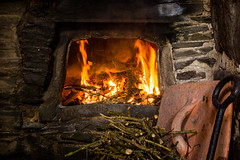 [2013-03-18@11.22.41a] (Untempered Photography) Tags: history fire cornwall oven flame heat nationaltrust twigs 14thcentury tintagel gorse canonef50mmf14 clayoven tintageloldpostoffice untemperedeye canoneos5dmkiii untemperedeyephotography cloamoven ovenfiring cloamovenfiring2013