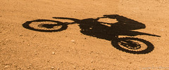 shadow biking (kimbenson45) Tags: blue shadow red orange motion colors bike sport jumping movement colorful colours action colourful banburymotocross wroxtonheath