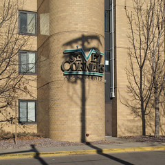 The elaborate Seven Corners Apartments logo is less impressive when it's getting messed with by a utility pole shadow at this time of year. (Tim Kiser) Tags: 1980s 1980sarchitecture 1980sbuilding 1983 1983architecture 1983building 19thavenue 19thavenuesouth 19thand2nd 2012 20120218 2ndstreet 2ndand19th cedarriverside cedarriversideneighborhood february february2012 hennepincounty hennepincountyminnesota img8939 minneapolis minneapolisminnesota minneapolissaintpaul minneapolisstpaul minnesota secondstreet sevencorners sevencornersapartments sevencornersapartmentslogo sevencornersapartmentssign south2ndstreet southsecondstreet twincities westbank westbankneighborhood apartmentbuilding apartmentwindows apartments appliedmasonry curb gravel landscapinggravel logo roundedwall shadows sign telephonepoleshadow treeshadow utilitypoleshadow windows yellowcurb unitedstates us