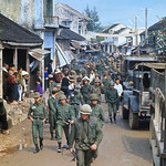 13 Feb 1968, Hue, South Vietnam - U.S. Marines and South Vietnamese troopers on street with refugees soon to be evacuated. thumbnail