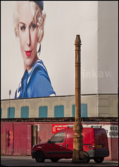 A giant poster, a red van and an old lampost (zolaczakl ( 2.5 million views, thanks everyone)) Tags: uk november england southwest streetlamp posters van templemeads georgerailwayhotel 2013 lunaphoto nikond90 photographybyjeremyfennell