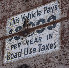Road Use Tax (-mtnoxx-) Tags: old sign typography wooden peeling paint distressed d5200