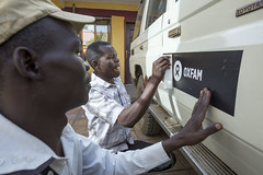 Juba, South Sudan, FEB 2014. Drivers of Oxfam add new stickers on newly aquiered cars..photo: Petterik Wiggers/Panos Pictures