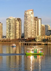 Rainbow reflections (Ruth and Dave) Tags: city morning light sea water ferry vancouver buildings reflections boats colours skyscrapers falsecreek inlet ripples aquabus